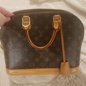 Louis Vuitton Alma MM bag